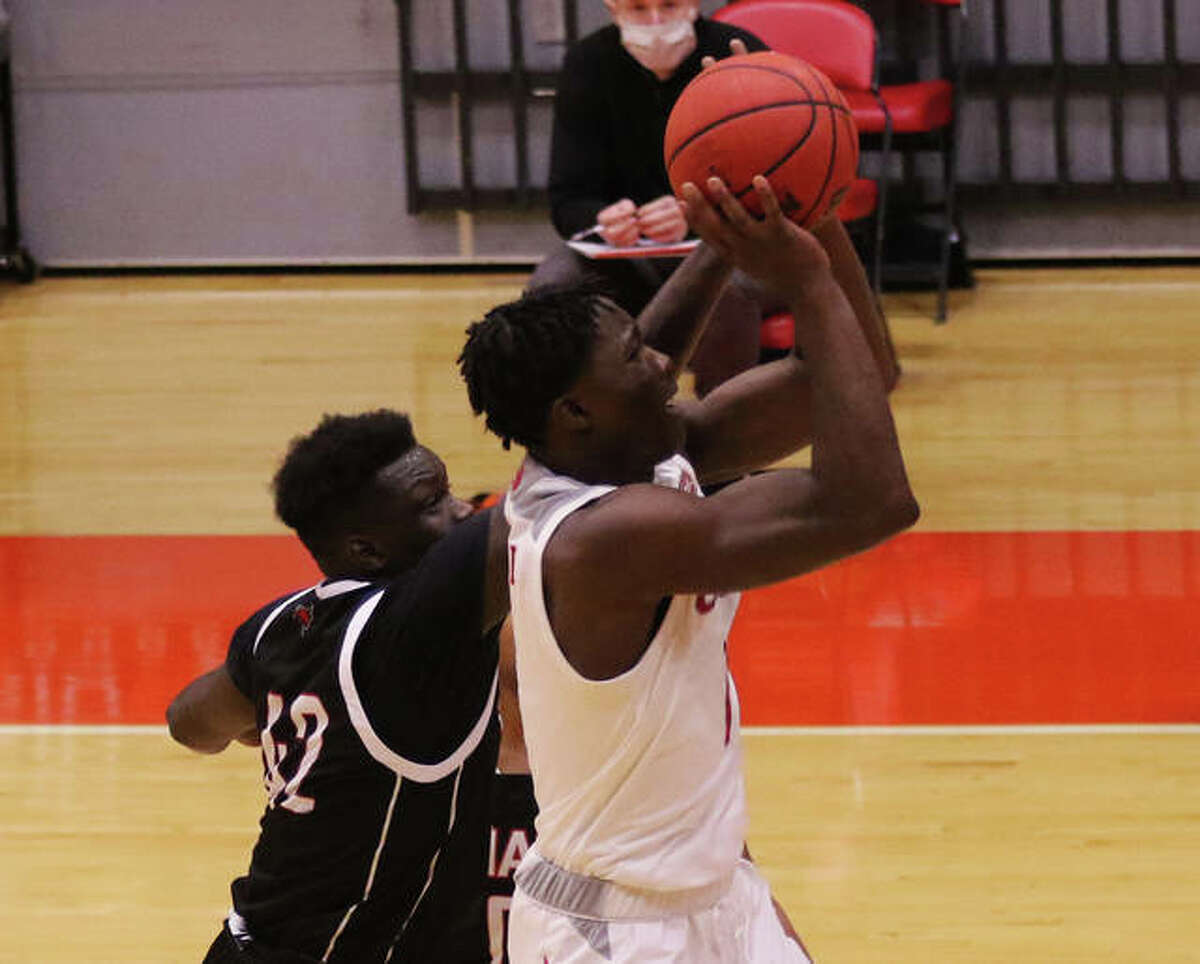 SIUE's Mike Adewunmi (right), shown taking a shot against Omaha in a game Dec. 5 at First Community Arena in Edwardsville, scored 18 points to lead the Cougars past Tennesee State on Thursday night in Nashville, Tenn.
