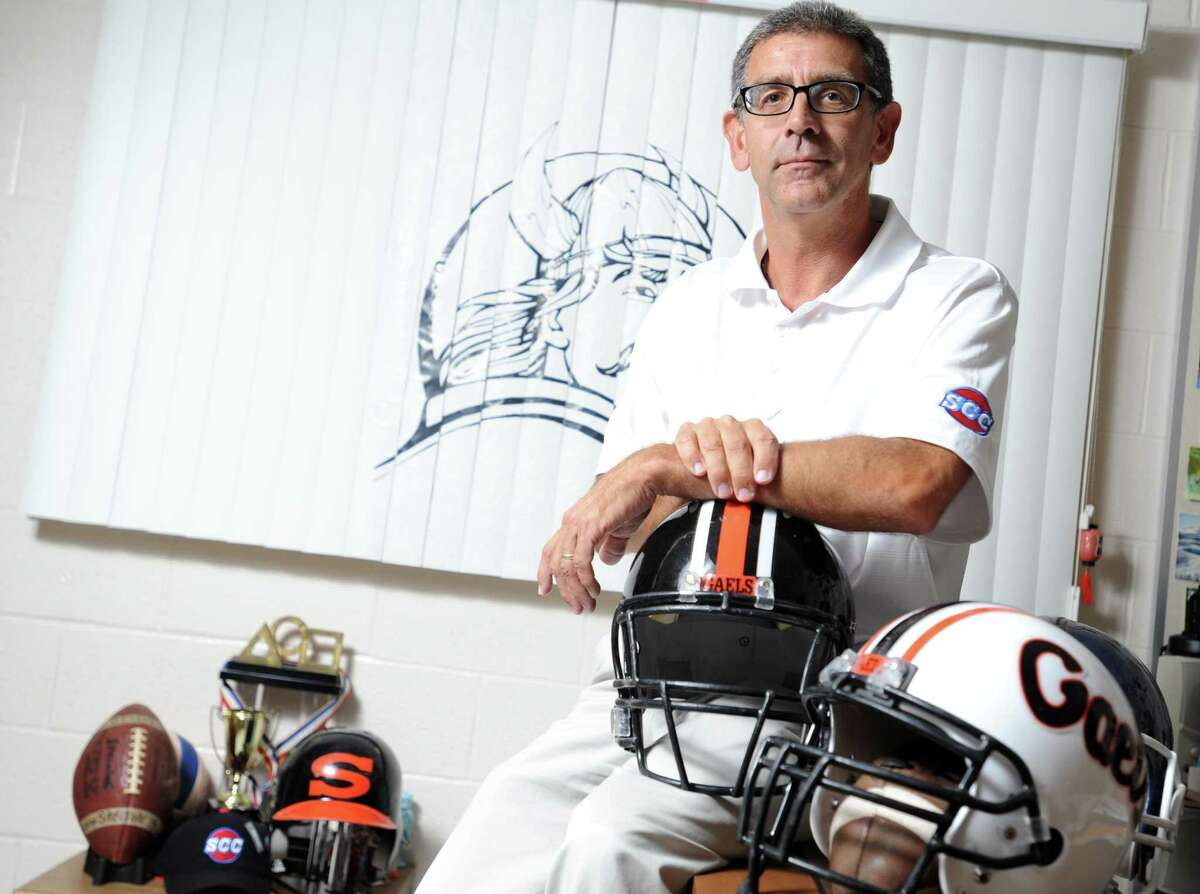 Shelton High School athletic director John Niski poses for a photograph in his office at the school in Shelton, Conn.