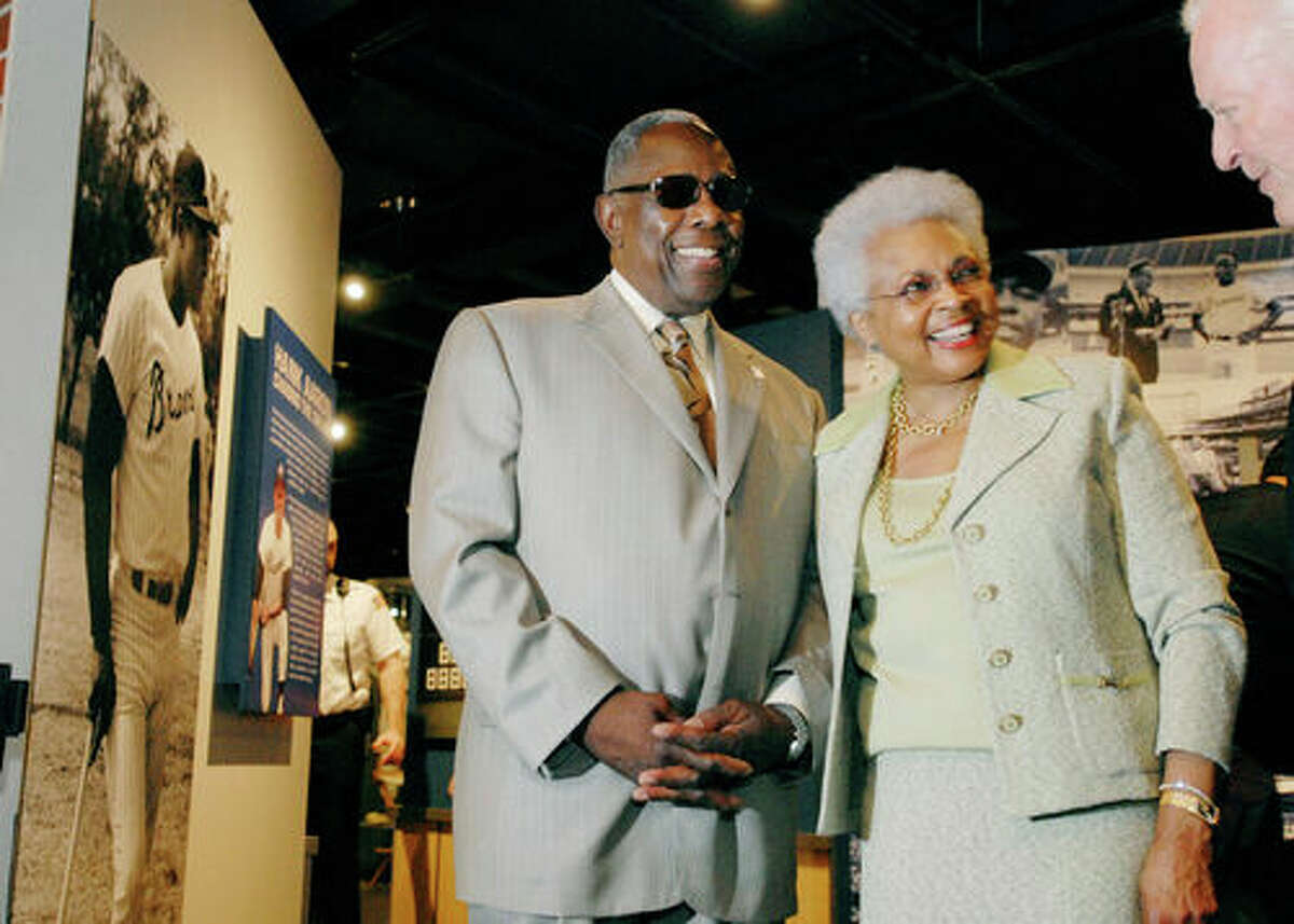 Major League Baseball Hall of Famer Hank Aaron and wife Billye Aaron attend the opening of a new historic permanent exhibit at the National Baseball Hall of Fame titled
