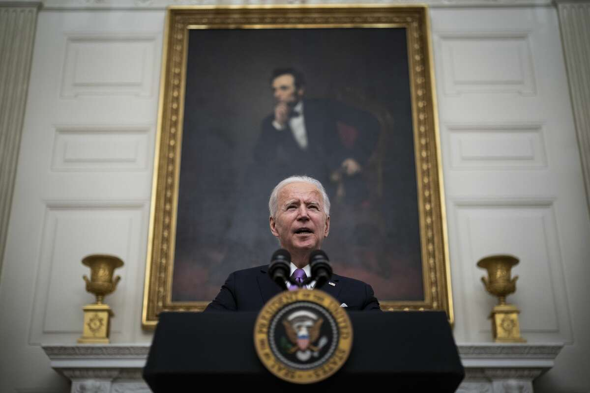 President Joe R. Bidenspeaks about the COVID-19 coronavirus pandemic before signing executive orders in the State Dining Room at the White House on Thursday, Jan 21, 2021 in Washington, DC.