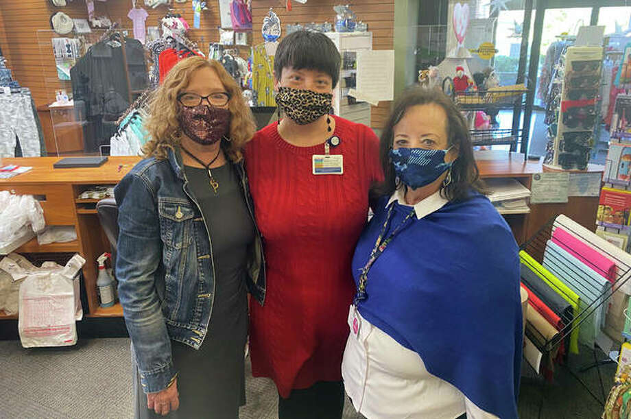 Mary Norman, center, has been named the coordinator of Miss Eunice's Hat Box inside Alton Memorial Hospital. She is pictured with Miss Eunice's Hat Box staff Pam Hill, left, and Barb Norman.