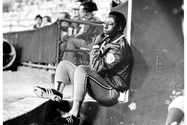 Hank Aaron inside the bullpen in Washington in 1976, near the end of his career.