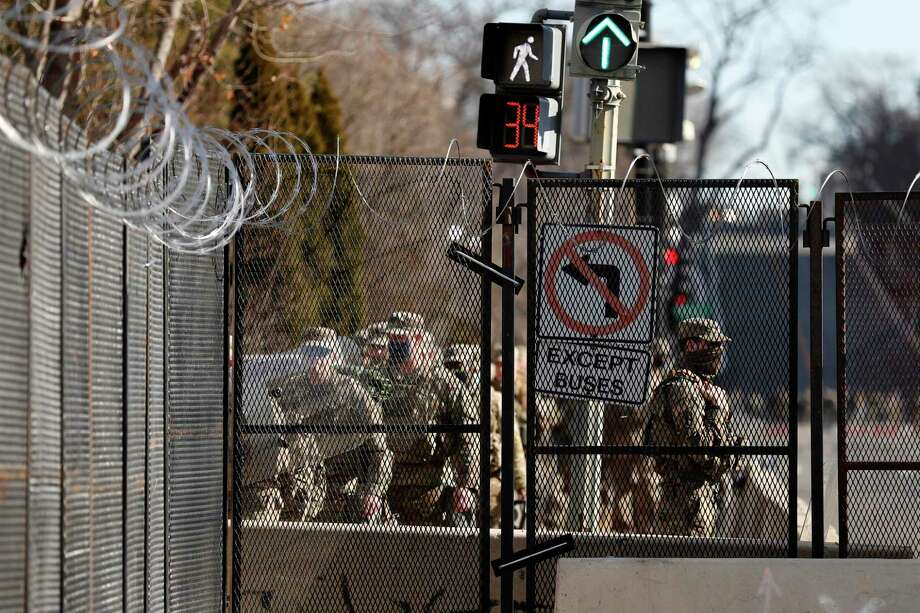 National Guard troops continue to be deployed around the Capitol a day after the inauguration of President Joe Biden. Photo: Associated Press / Copyright 2021 The Associated Press. All rights reserved