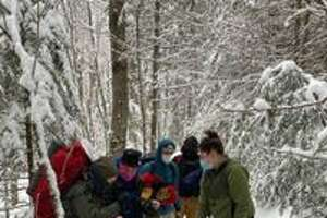 Forest rangers used a sled to haul an injured woman out of the woods in the Adirondacks.