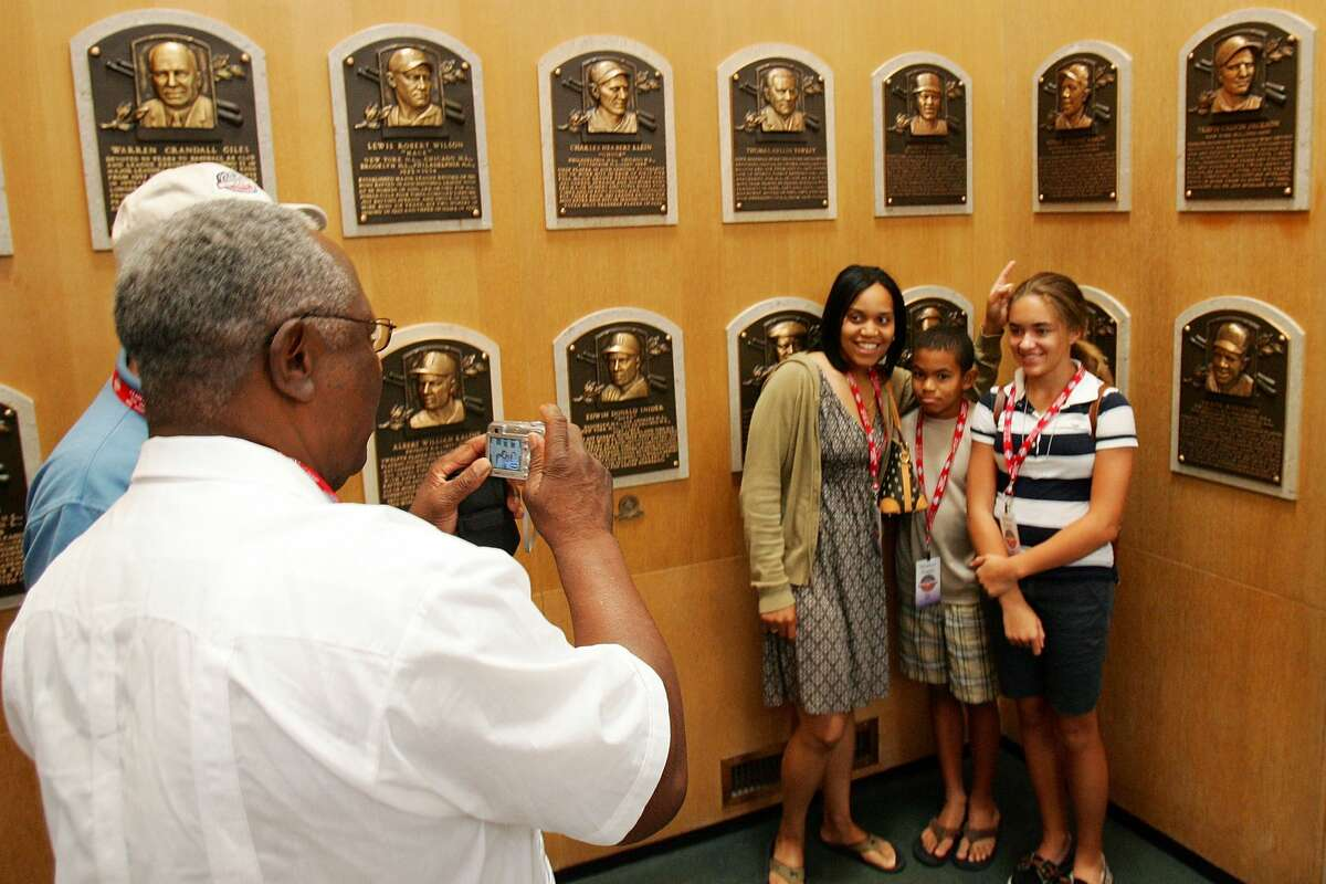 Baseball Hall of Famer Hank Aaron takes a photo of family members at the National Baseball Hall of Fame in 2008. Click through the gallery to view Hall of Famers in the Albany International Airport.
