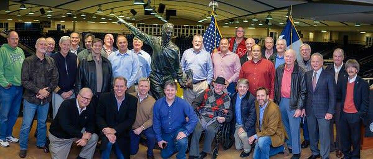 Former players and coaches celebrate with Don Coleman as a statue of him is unvieled at his namesake Don Coleman Coliseum on November 14, 2019