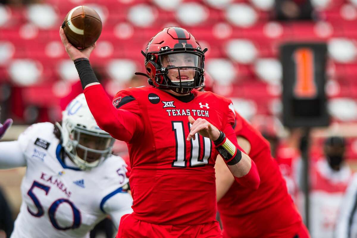 LUBBOCK, TEXAS - DECEMBER 05: Quarterback Alan Bowman #10 of the Texas Tech Red Raiders passes the ball during the second half of the college football game against the Kansas Jayhawks at Jones AT&T Stadium on December 05, 2020 in Lubbock, Texas. (Photo by John E. Moore III/Getty Images)