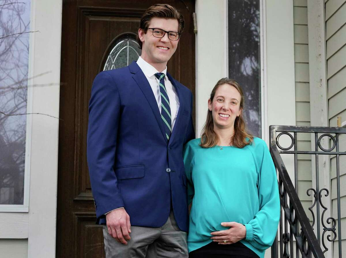 Matthew Hansel with his wife, Abbie Kamin, a Houston City Councilmember, who is eight months pregnant and will soon get the COVID-19 vaccination, are shown Thursday, Jan. 21, 2021 in Houston.