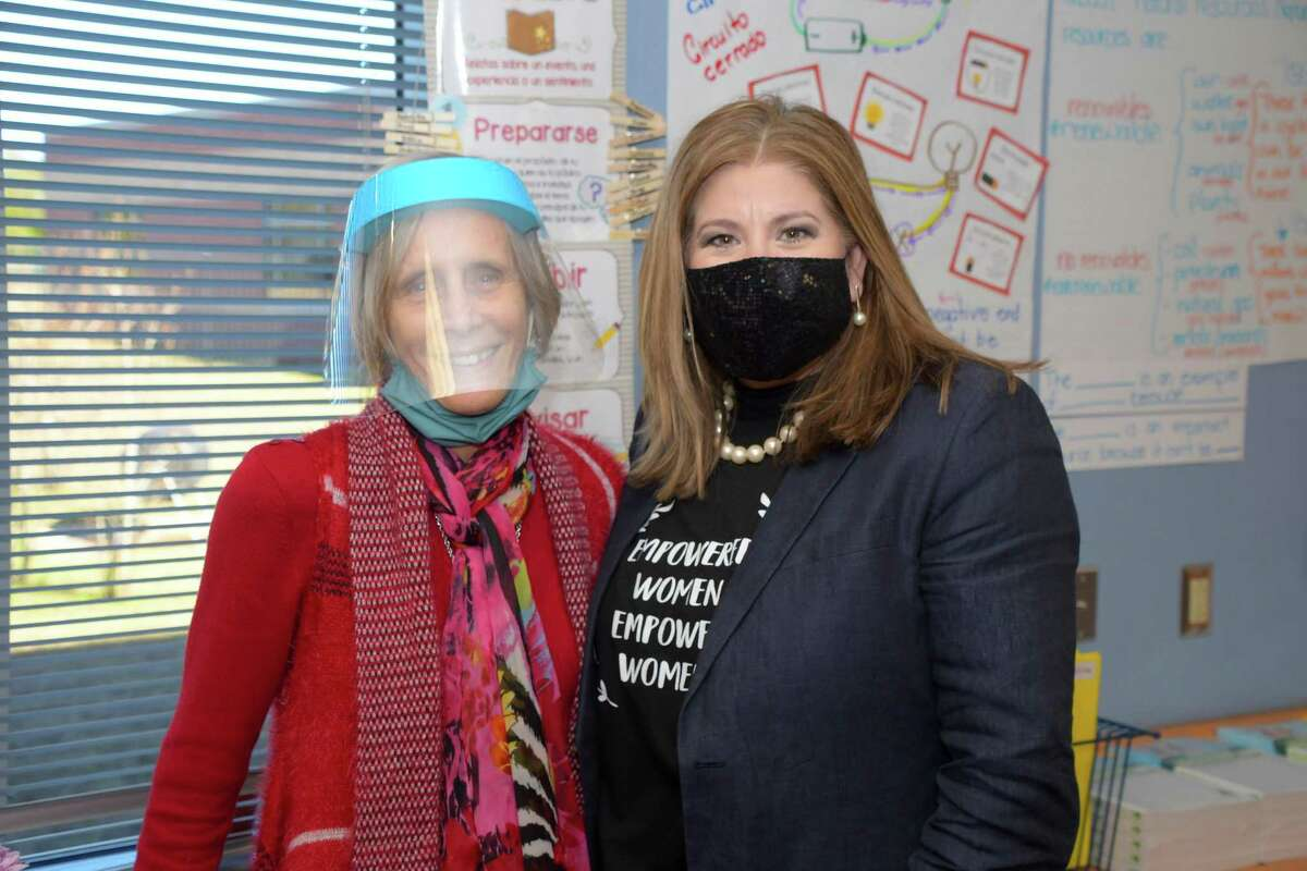 Tomball ISD staff member Winnie Vanderborgh and Superintendent of Schools Martha Salazar-Zamora celebrate Vanderborgh's 80th birthday, Friday afternoon, Jan. 15, at Rosehill Elementary.