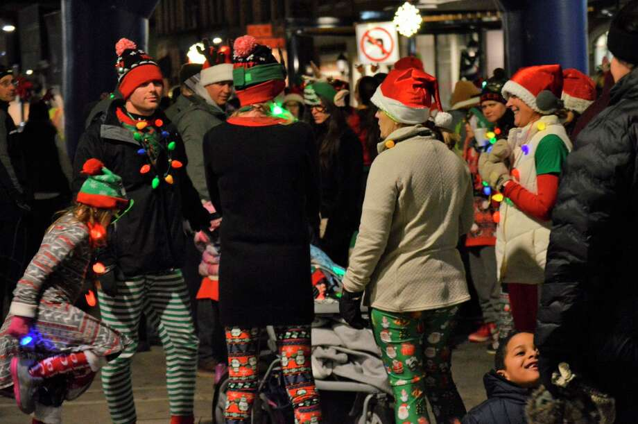 Members of the community, many of which were dressed in holiday-themed gear, gathered in downtown Midland for the Jingle Bell Fun Run/Walk on Thursday, Dec. 5, 2019. (Daily News file photo)