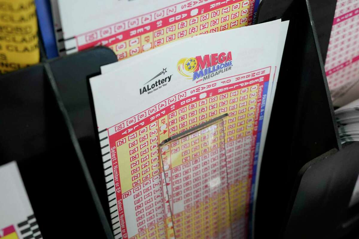 A file photo of blank forms for the Mega Millions lottery.