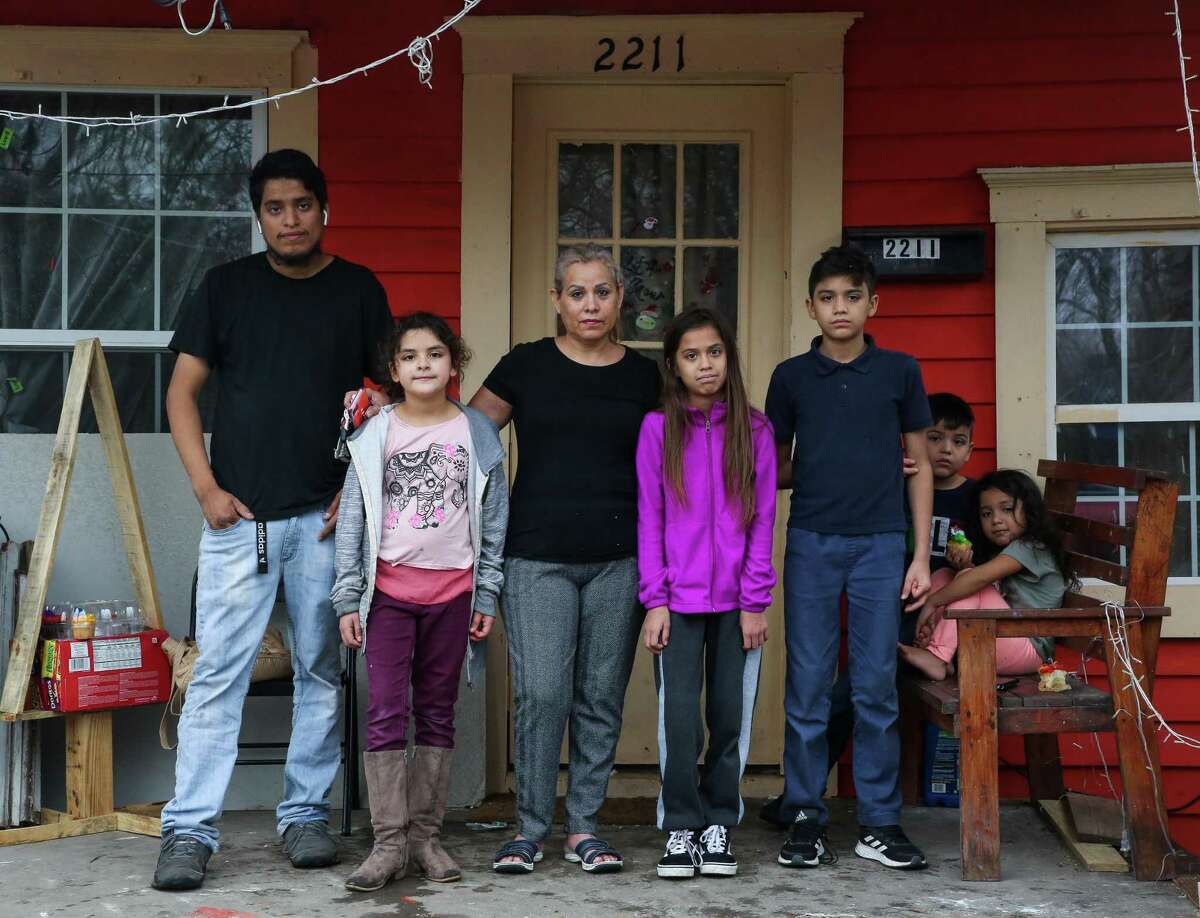 Rosa Maciel, center, and her son and grandchildren pose for a photograph on her front porch Jan. 21, 2021, in Houston. Maciel lives with her son and three grandchildren in Kashmere Gardens, which along with Fifth Ward, has been identified by a state investigation in a newly released report as a place where children contracted leukemia at nearly five times the expected rate of the general population.