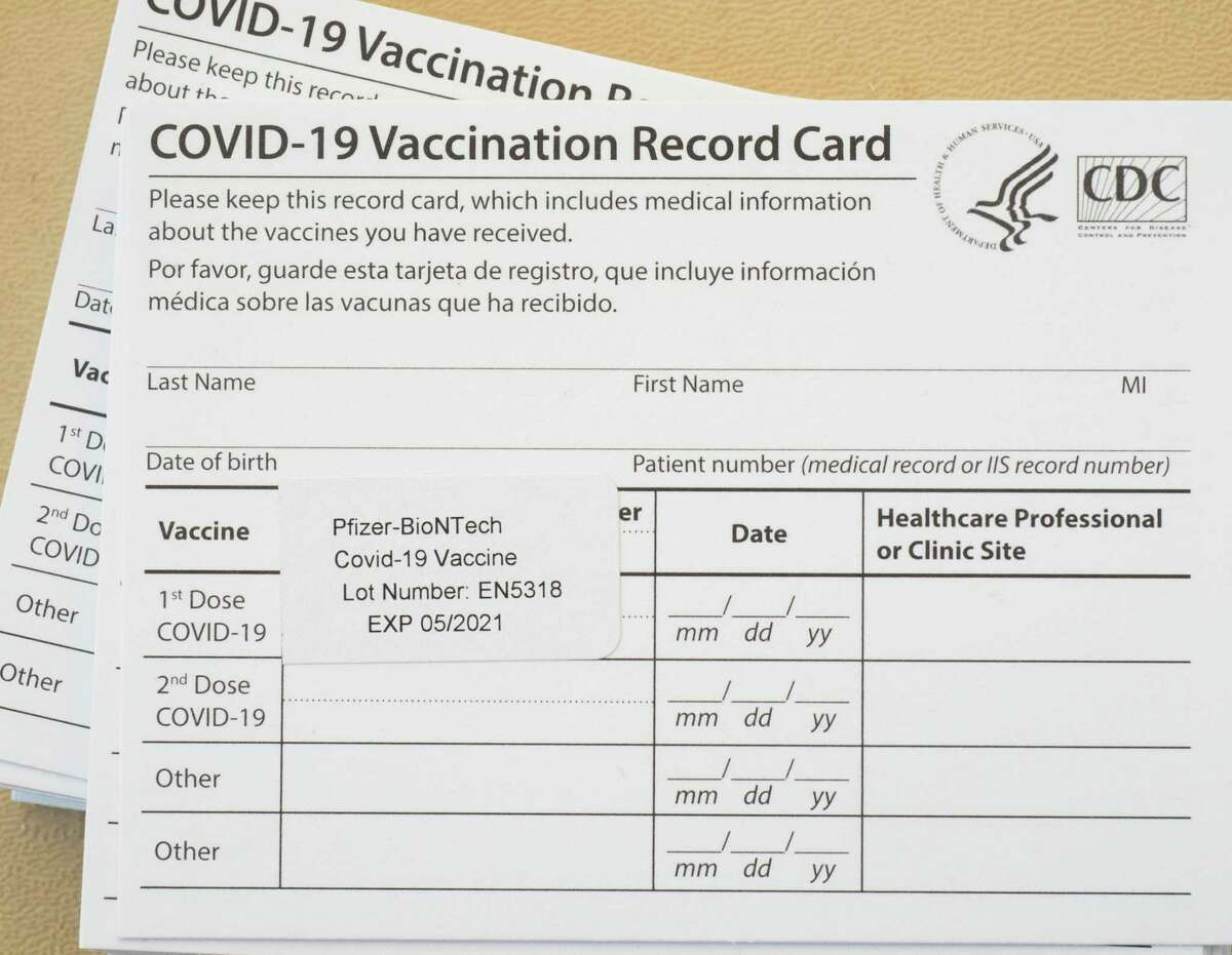 Each person will receive and be told to keep their vaccination record card 01/22/2021 after receiving their COVID-19 vaccination. Tim Fischer/Reporter-Telegram