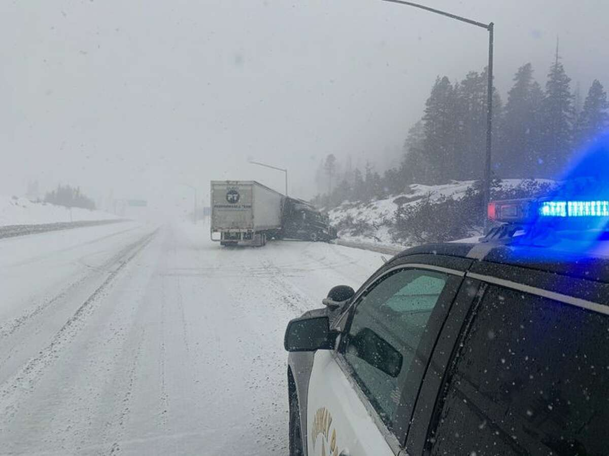 A stretch of I-80 through the Sierra was closed Monday due to snow and spinouts.