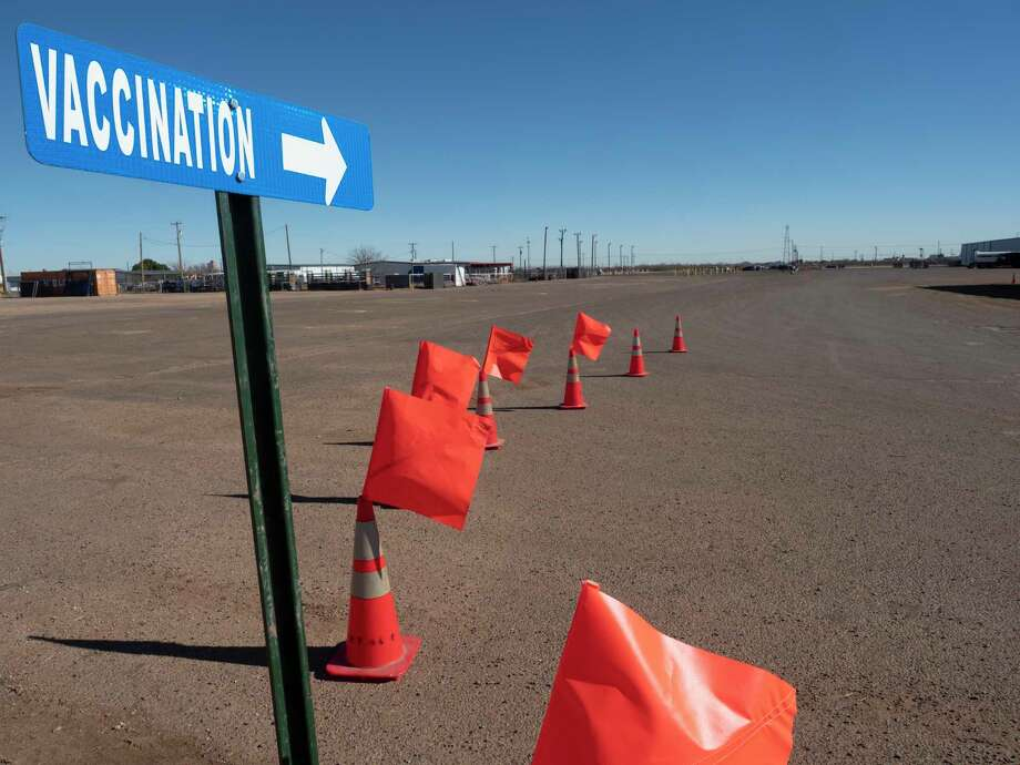 Street signs and cones have been put up around the Horseshoe Arena 01/22/2021 directing drivers to the back side of the main Horseshoe Arena to enter the vaccination site. Tim Fischer/Reporter-Telegram Photo: Tim Fischer, Midland Reporter-Telegram