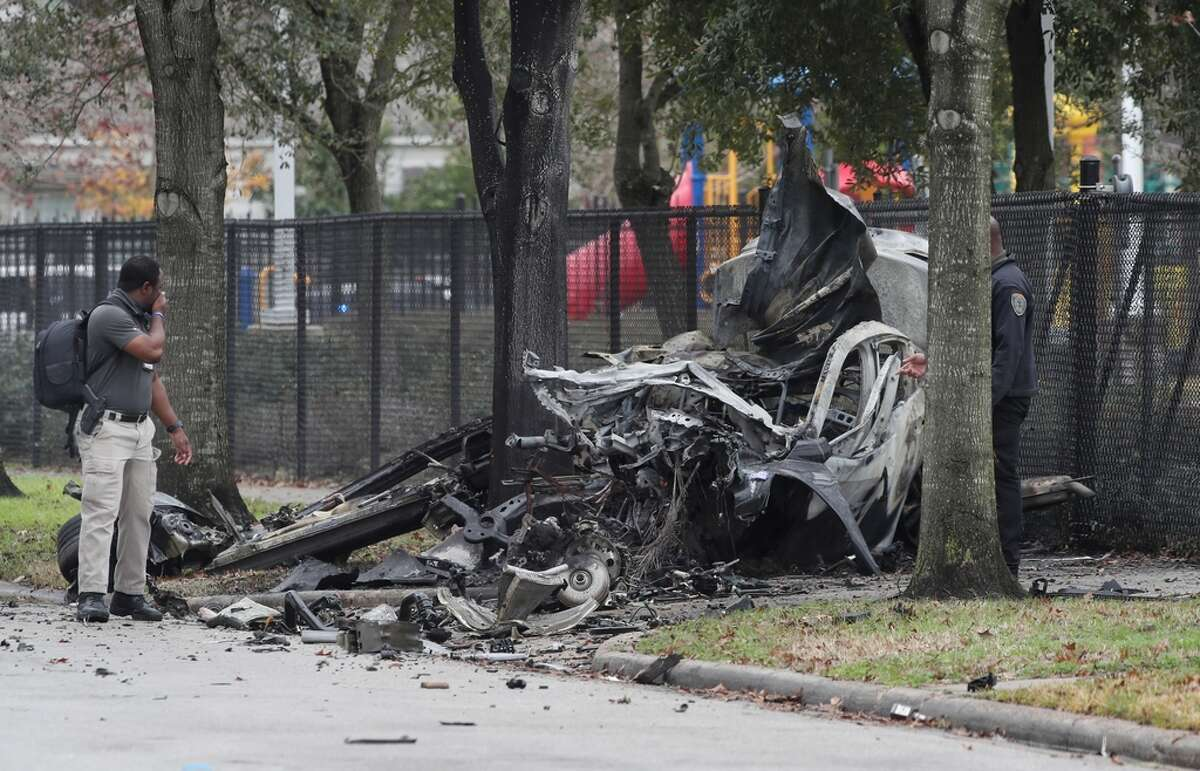 Authorities investigate the scene of a fatal crash near Southmayd Elementary School, near the intersection of Coral Street and Kernel Street, on Friday, Jan. 22, 2021, in Houston.