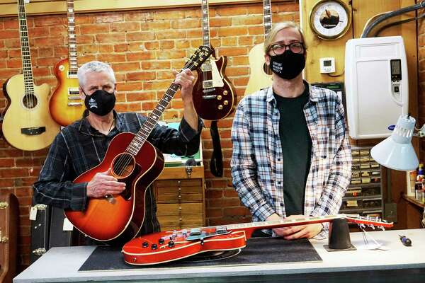 From left to right: Quinn's Music owner Marc Conley and guitar technician Zach Potter. (Pioneer photo/Joe Judd)