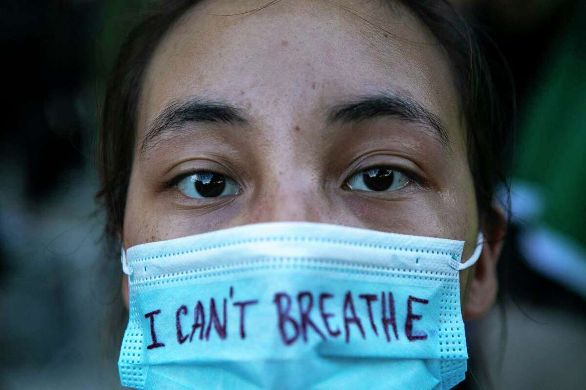 Emily Brieno is among those protesting in memory of George Floyd in downtown in San Antonio, Texas, on May 30, 2020. Floyd died in the custody of Minneapolis police and his death has sparked protests across the country.