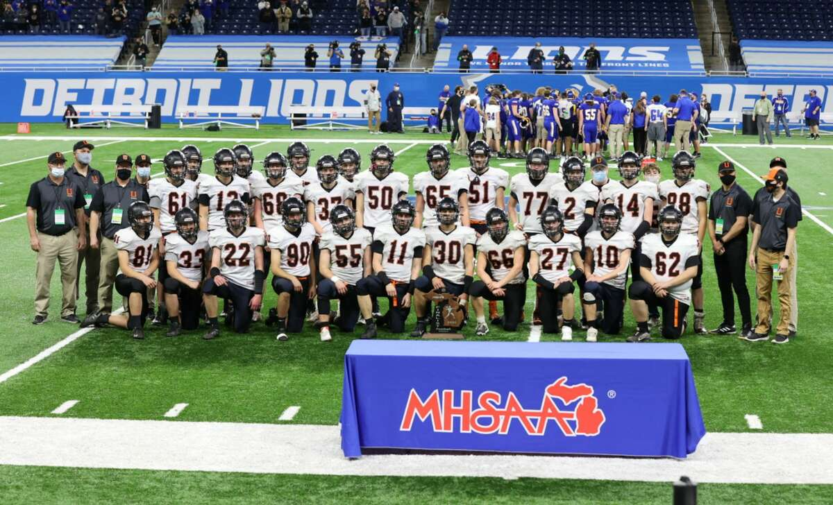 The Ubly Bearcats pose with their MHSAA Division 8 runner-up trophy at Ford Field in Detroit on Friday. The Centreville Bulldogs topped the Bearcats, 22-0, to claim the championship.