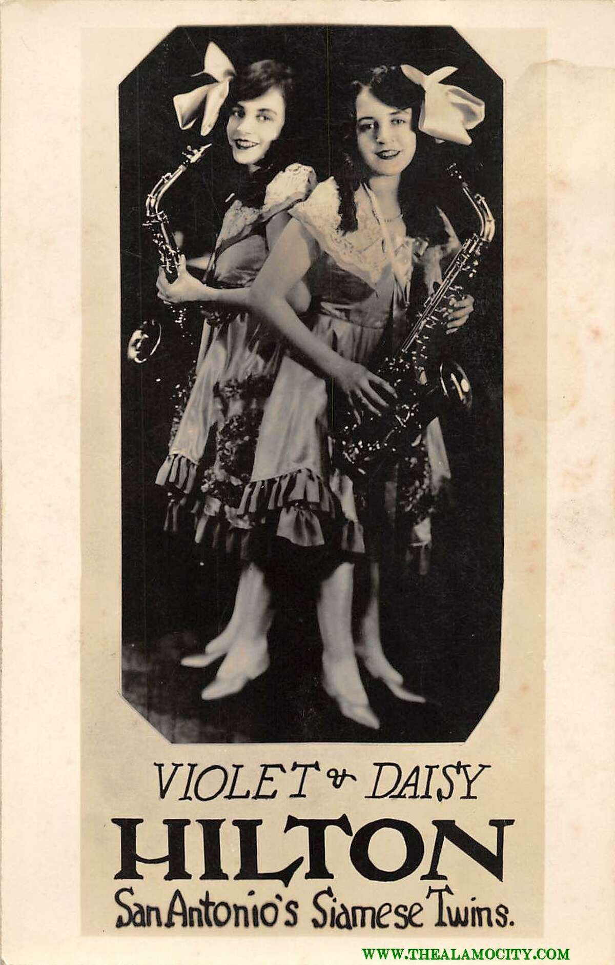 Joseph Cooper's vintage San Antonio postcards collection includes two cards featuring conjoined twins Violet and Daisy Hilton, who in the 1920s were billed as the San Antonio Siamese Twins. This particular postcard is autographed by the twins.