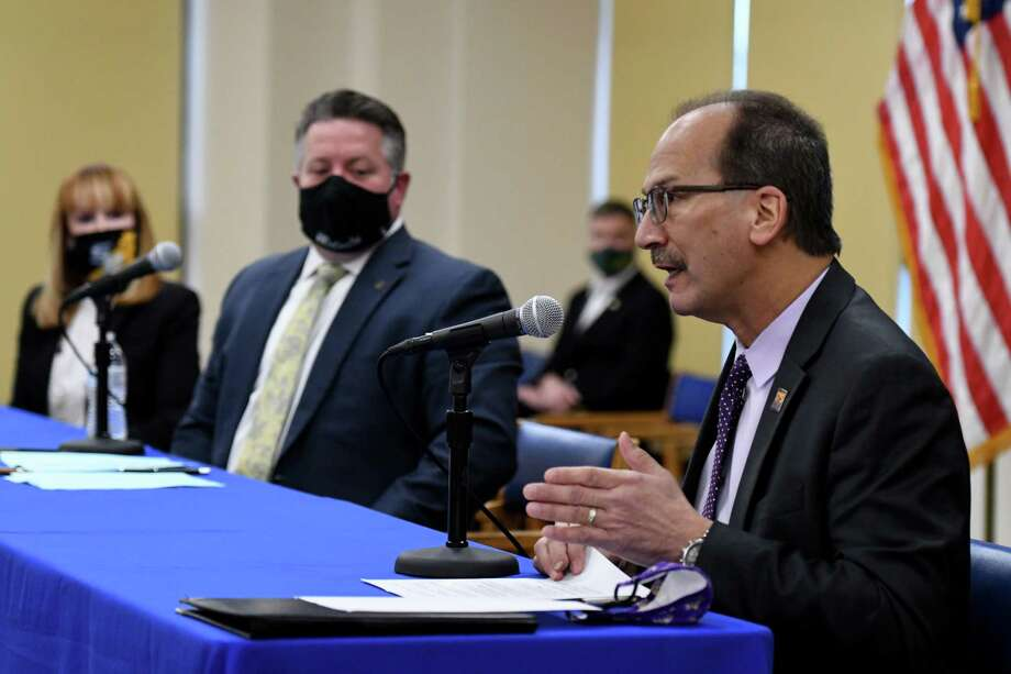 University at Albany President Havid‡n Rodriguez, right, joins Albany County Executive Dan McCoy, center, during a joint coronavirus news conference with The College of Saint Rose President Marcia White, left, and Siena College President Christopher Gibson, background, on Friday, Jan. 22, 2021, at the Albany County offices in Albany, N.Y.  (Will Waldron/Times Union) Photo: Will Waldron, Albany Times Union
