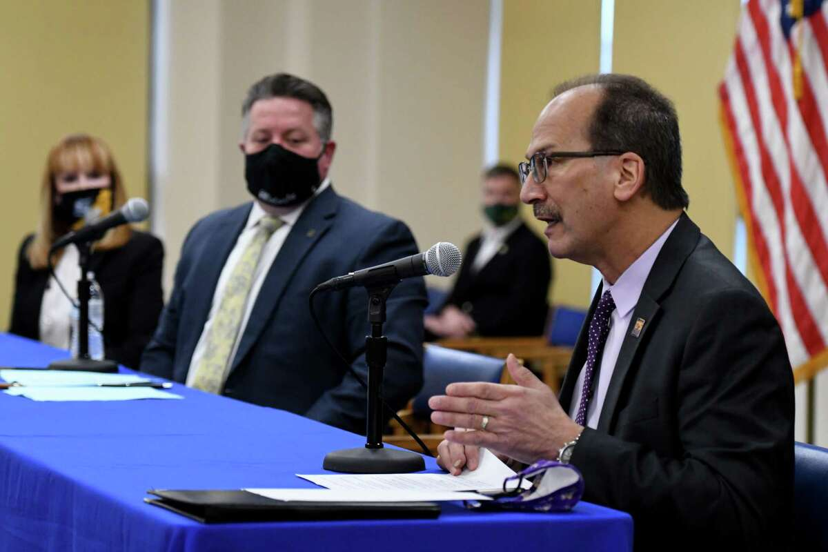University at Albany President Havid‡n Rodriguez, right, joins Albany County Executive Dan McCoy, center, during a joint coronavirus news conference with The College of Saint Rose President Marcia White, left, and Siena College President Christopher Gibson, background, on Friday, Jan. 22, 2021, at the Albany County offices in Albany, N.Y. (Will Waldron/Times Union)