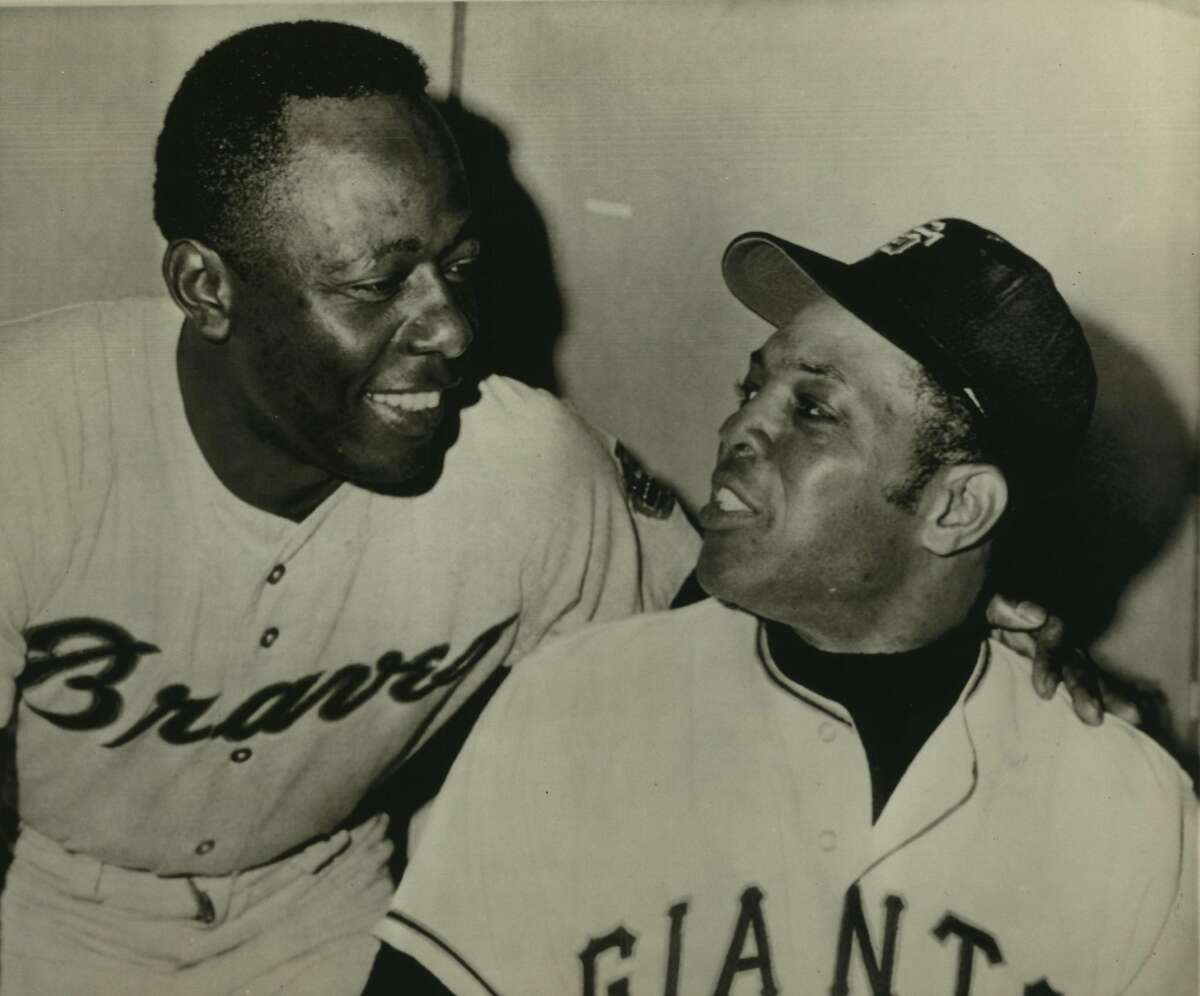 Baseball. Hank Aaron. San Francisco--A Look Over The Shoulder--Willie Mays, right, San Francisco Giants, looks over his shoulder at smiling Hank Aaron of the Atlanta Braves in the clubhouse before last night's game. Mays has a lifetime total of 608 home runs, second only to Babe Ruth's 714. Aaron, who has hit 16 this year, has a total of 570. He also got his 3,000th hit last Sunday against Cincinnati. Mays has 8 home runs to date this year.