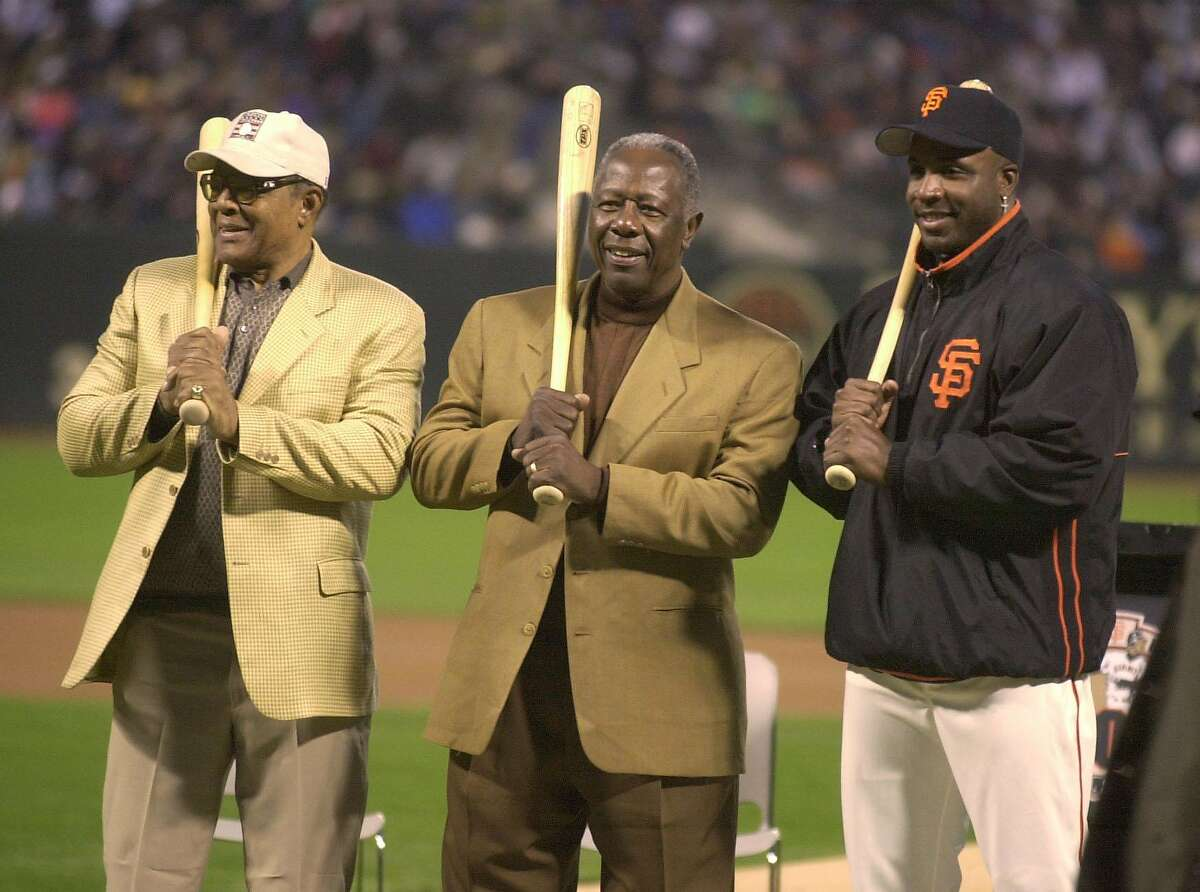 Willie Mays (left), Hank Aaron, and Barry Bonds - three of the greatest home run hitters of all-time - pose at Pac Bell Park in 2002, after Bonds had joined the 600 club.