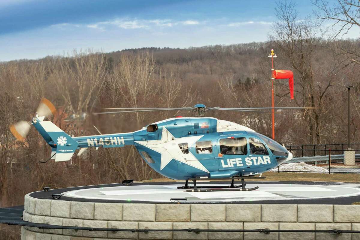 Hartford HealthCare's new healthcare center, located at 80 South Main Street at the corner of Routes 8 and 44 in Winsted, opened Thursday with ceremonies, a ribbon-cutting and donations. Above, LifeStar made a ceremonial landing on the center's new helipad Thursday during the ceremony.