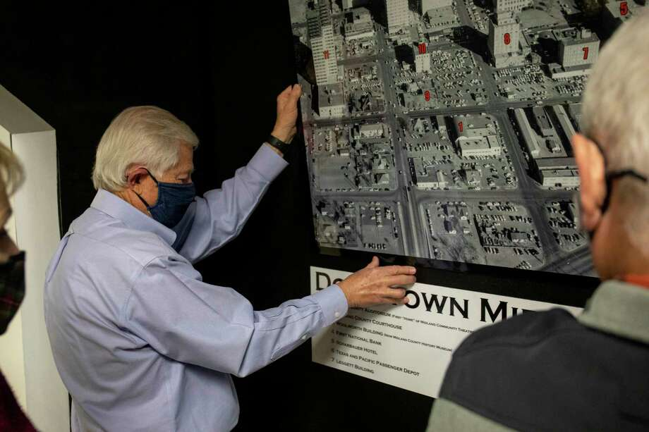 Jim Collett hangs a map of old downtown in the Midland Community Theatre exhibit Jan. 7, 2021 at Midland County History Museum.  Jacy Lewis/Reporter-Telegram Photo: Jacy Lewis/Reporter-Telegram