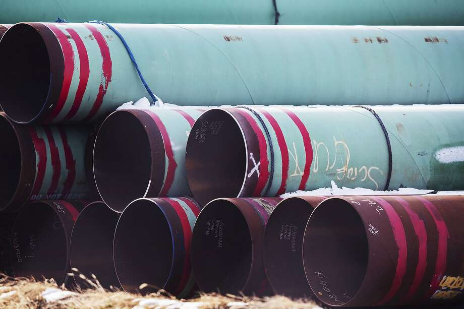 In this Dec. 18, 2020 photo, pipes to be used for the Keystone XL pipeline are stored in a field near Dorchester, Neb. In one of his first acts as president, President Joe Biden cancelled the permit for the Keystone XL Pipeline, which would bring oil sands oil from Alberta, Canada to the Gulf Coast. Photo: Chris Machian, Associated Press