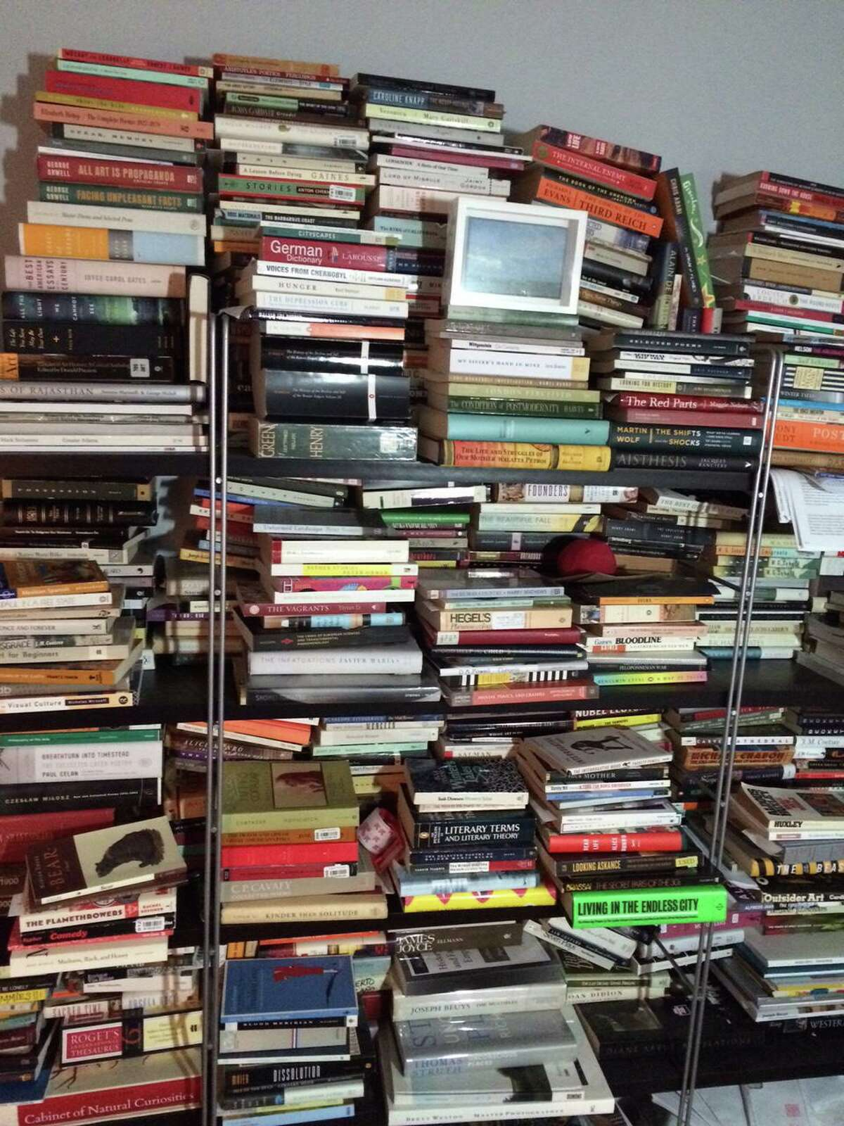 Shelves filled with books are much harder to manage than a Kindle Fire. De-clutter!