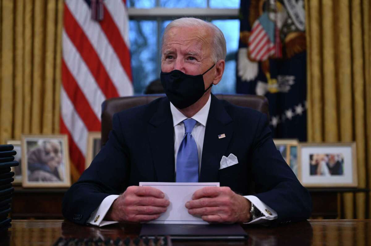 President Joe Biden prepares to sign a series of orders in the Oval Office last week. Biden has pledged unity - don't expect that to manifest.