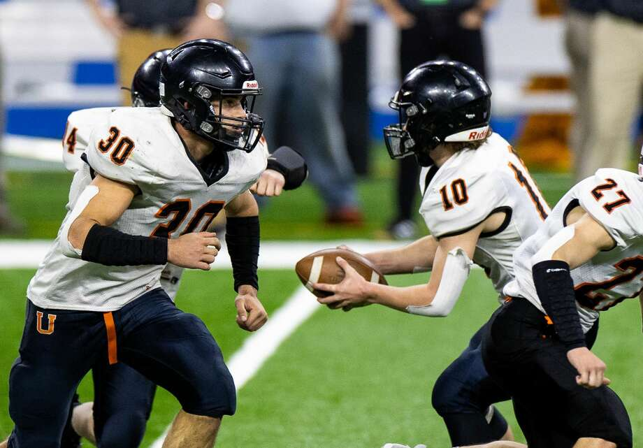 The Centreville Bulldogs topped the Ubly Bearcats in the Division 8 championship game at Ford Field in Detroit on Friday. the Bulldogs won, 22-0. Photo: Quad N Productions For The Tribune / Quad N Productions