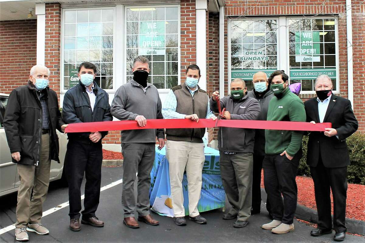 Lapels Dry Cleaning in Cromwell held a grand opening Jan. 19. From left are Middlesex County Chamber of Commerce President Larry McHugh, Cromwell Town Planner Stuart Popper, Cromwell Division Chairman Rodney Bitgood, Mayor Enzo Faienza, Owner Geronimo Valdez, Town Manager Tony Salvatore, Store Manager Brandon Valdez and past chamber Chairman Jay Polke.