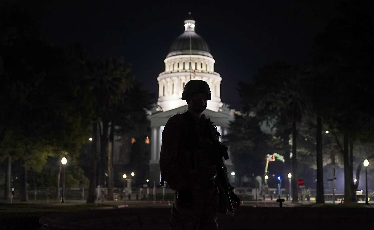 A member of the California National Guard keeps watch near California's Capitol in the days before President Biden's inauguration.