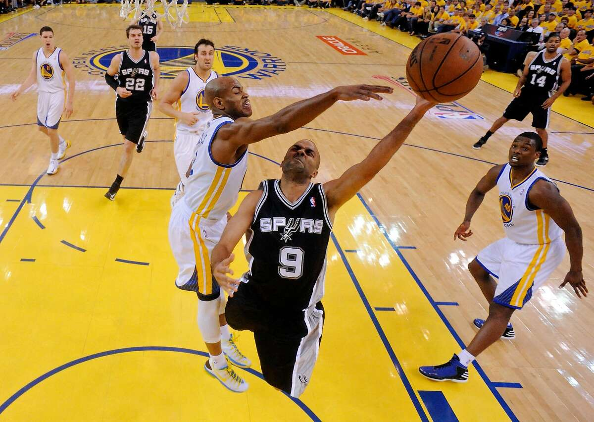 San Antonio Spurs' Tony Parker shoots around Golden State Warriors' Jarrett Jack during first half action of Game 6 in the NBA Western Conference semifinals Thursday May 16, 2013 at Oracle Arena in Oakland, CA.