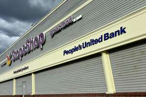 A People's United Bank sign displayed outside of the Stop & Shop in Milford on Friday.