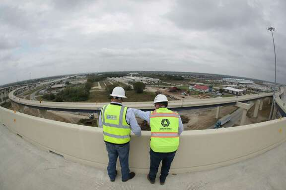 Sam Sauceda and Sean Lind take in the view on the ramp from the southbound Texas 288 Tollway to the eastbound Sam Houston Tollway on Nov. 13, 2020, in Houston.