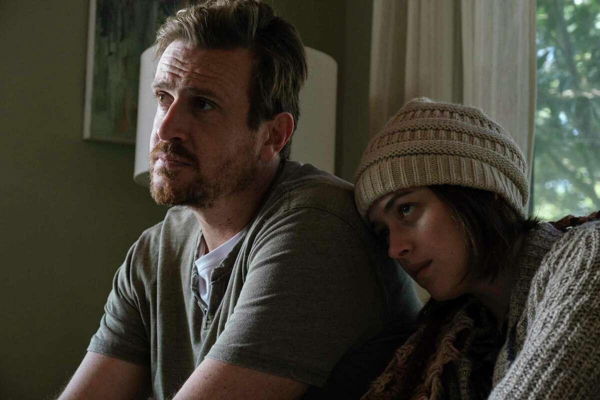 Jason Segel, left, and Dakota Johnson in a scene from