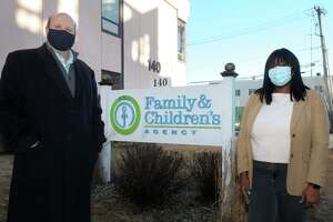 Chris Jachino, Director of Homeless Services and Lorraine Reid-James, CAN Manager for Minors, pose in front of The Family and Children's Agency, in Norwalk, Conn. Jan. 22, 2021.