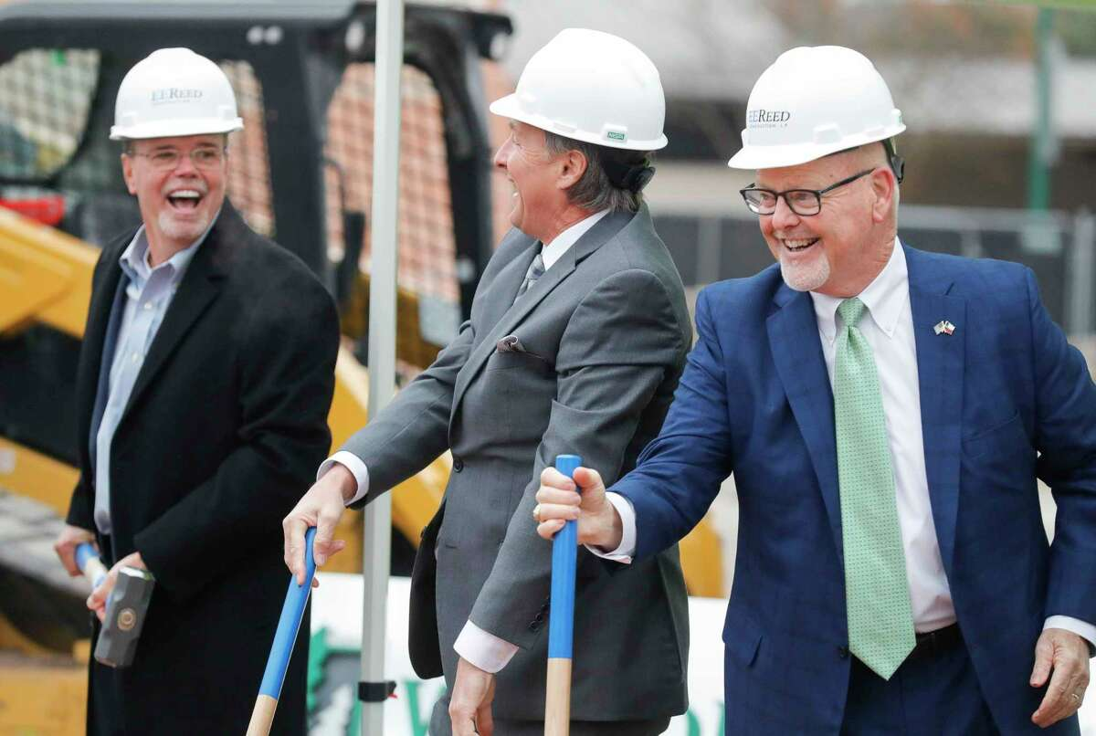 Woodforest Bank president and CEO Jay Dreibelbis, right, shares a laugh beside Conroe Mayor Pro Tem Raymond McDonald, center, and Robert Marling, Woodforest Bank founer and chairman, during a groundbreaking ceremony for a new Woodforest Bank building along West Davis Drive, Tuesday, Dec. 15, 2020, in Conroe.