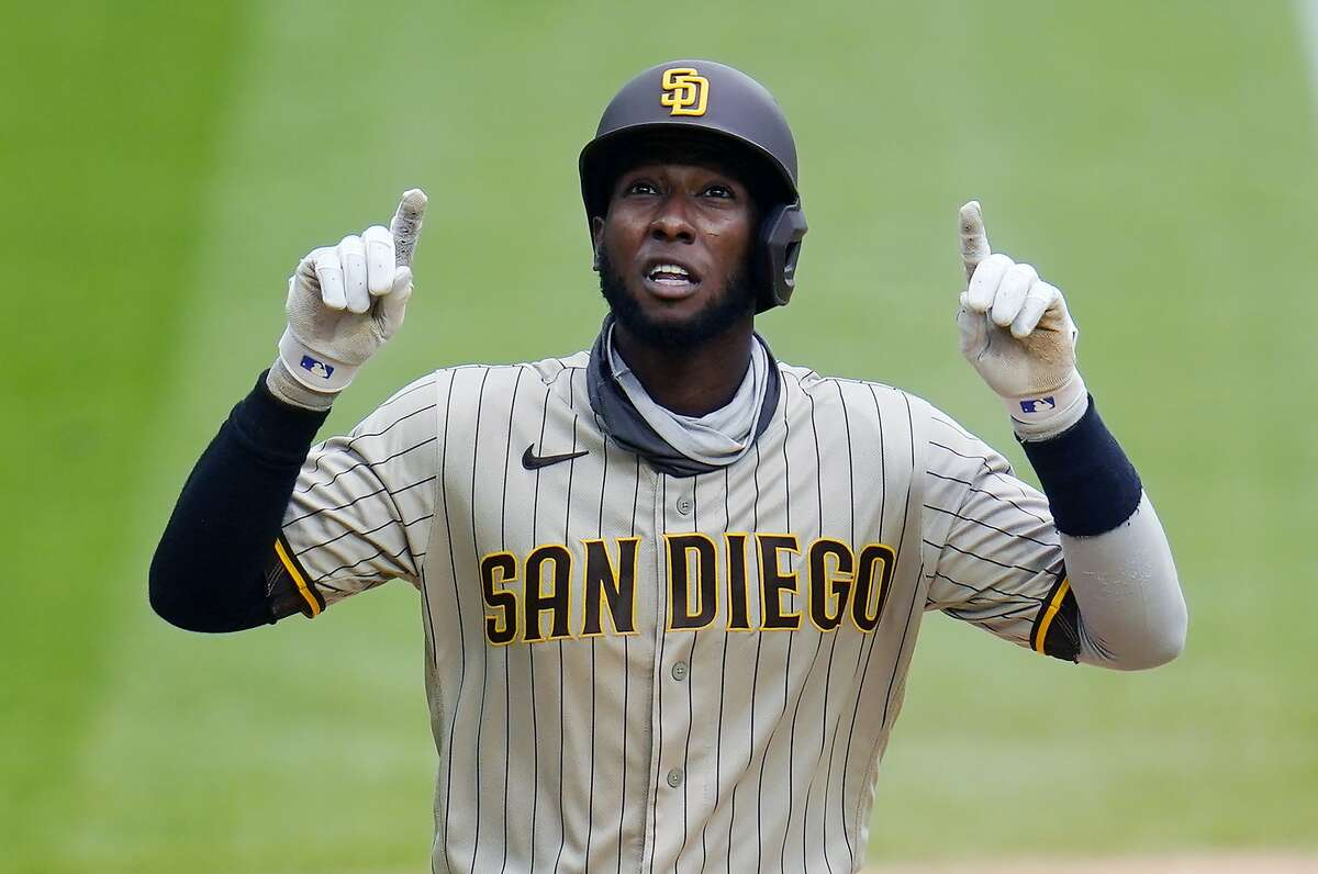 FILE - San Diego Padres' Jurickson Profar gestures as he circles the bases after hitting a solo home run off Colorado Rockies relief pitcher James Pazos in the eighth inning of a baseball game in Denver, in this Sunday, Aug. 30, 2020, file photo. Profar is staying with the San Diego Padres, agreeing to a $21 million, three-year contract, a person familiar with the negotiations told The Associated Press. The person spoke on condition of anonymity Friday, Jan. 22, 2021, because the agreement is subject to a successful physical. (AP Photo/David Zalubowski, File)