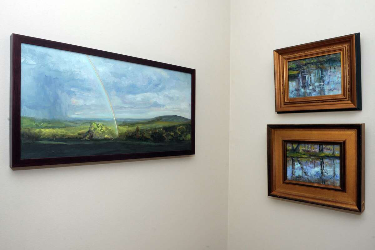 Dozens of Jill Nichols' paintings decorate the walls of her home and studio in Shelton, Conn. Jan. 22, 2021.