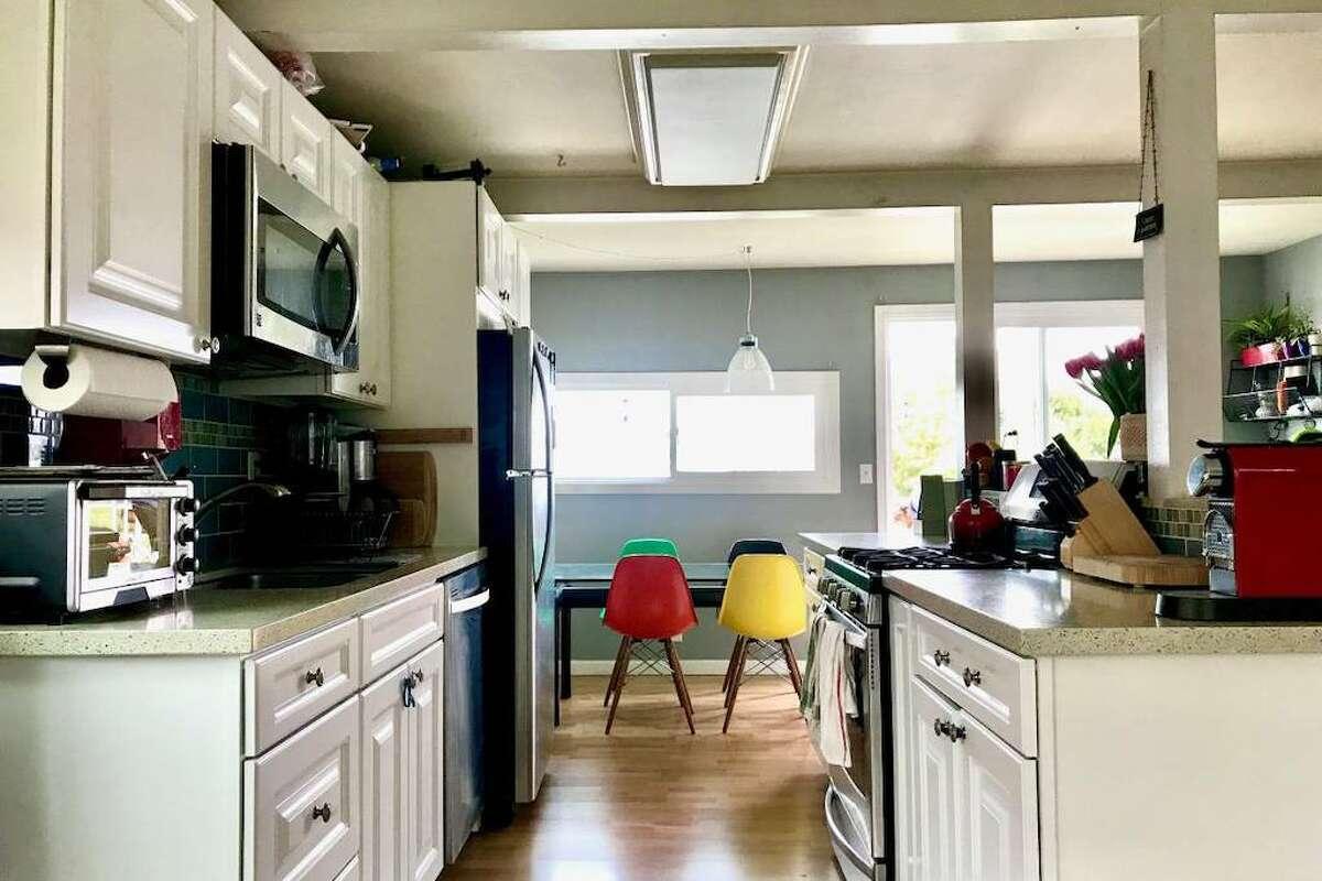 The kitchen looks fairly modern.