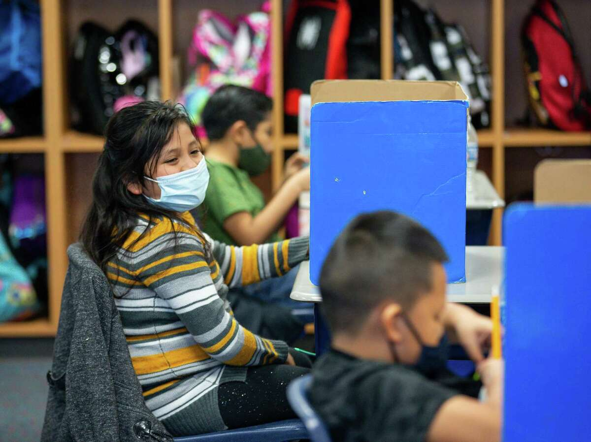 Miranda Zertuche, bottom right, and her fellow bilingual third grade classmates take a test at Calder Road Elementary on Friday, Jan. 15, 2021, in Dickinson, Texas. More than 40,000 students have opted to return to campuses for instruction despite a surge in COVID-19 infections. In Dickinson ISD, 93 percent of students are back in their classrooms.