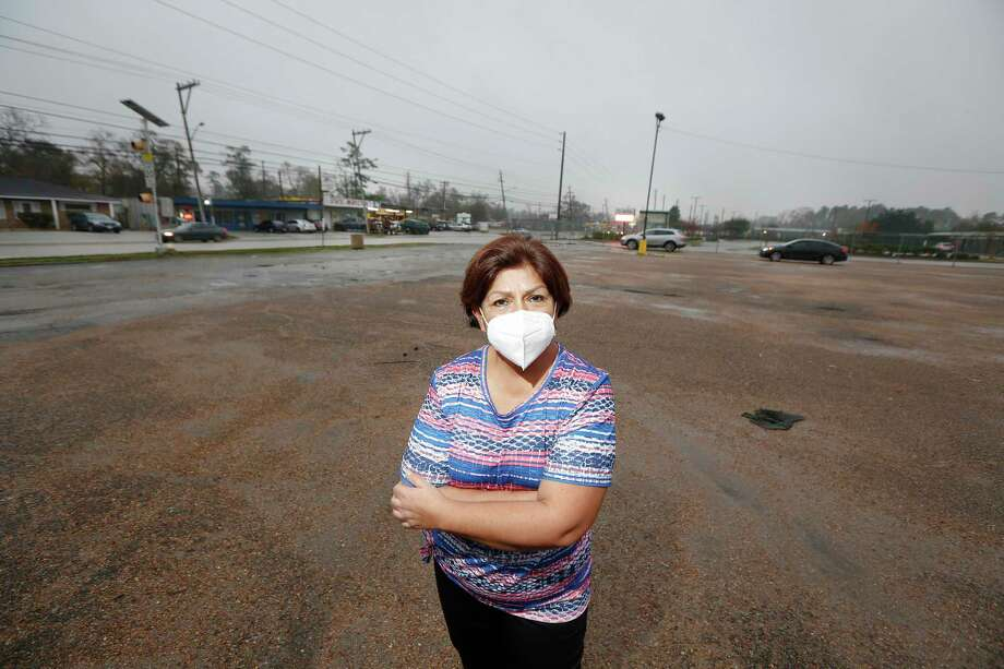 Myrtala Tristan stands in a parking lot across from her neighborhood that she said she had to wade or boat out during heavy rains Thursday, Jan. 21, 2021, in Houston. Photo: Steve Gonzales, Houston Chronicle / Staff Photographer / © 2021 Houston Chronicle