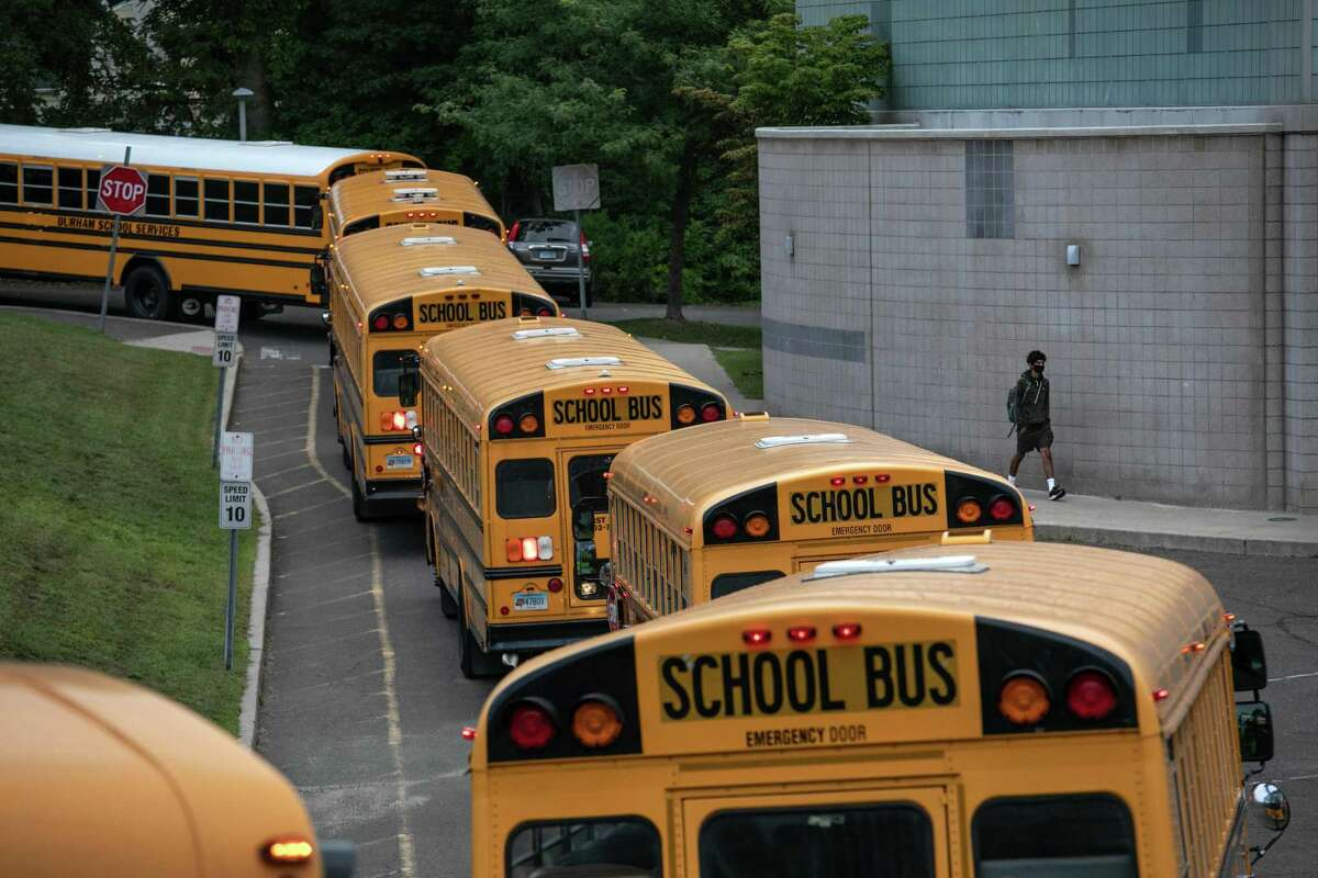 Buses depart after dropping off students at Rippowam Middle School on September 14, 2020 in Stamford, Connecticut.