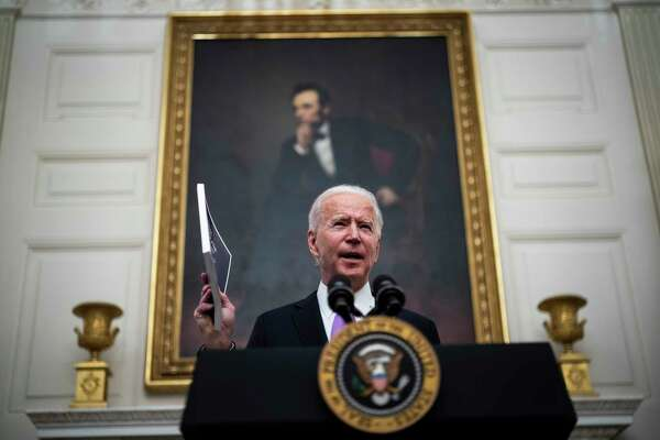 President Biden speaks about the coronavirus pandemic before signing executive orders at the White House on Jan. 21.