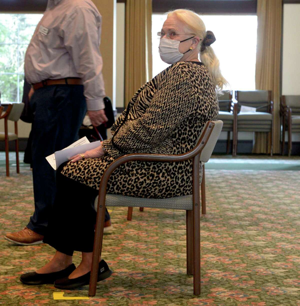 Gerd Hammarskjold a resident of Meadow Ridge senior living, waits to receive her covid-19 vaccination on Friday. January 22, 2021, in Redding, Conn.